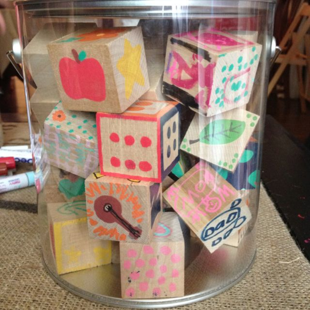 have baby shower guests decorate wooden blocks with paint pens 1 1 2
