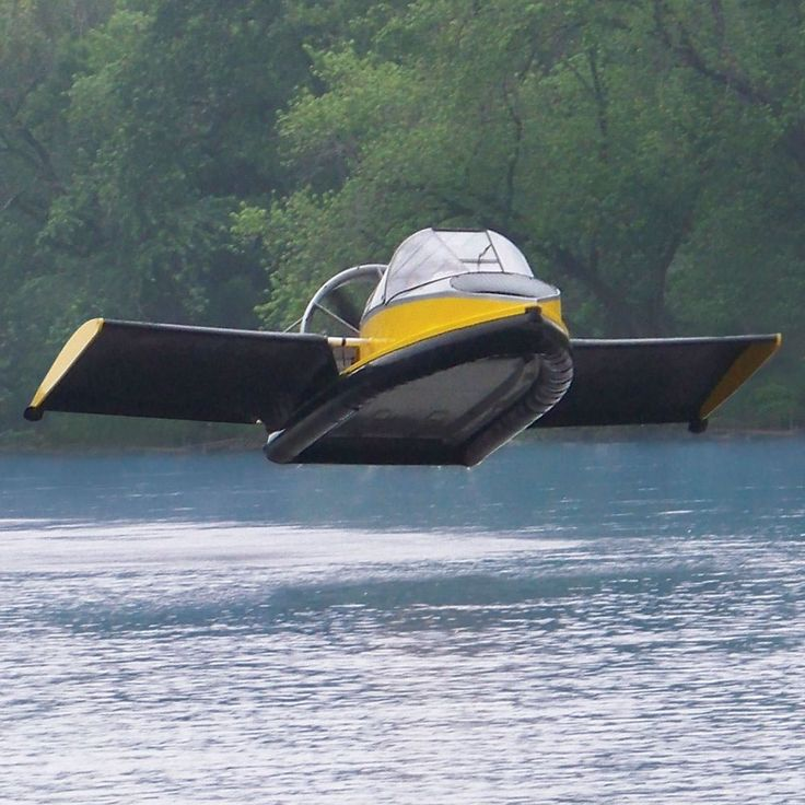 """The Flying Hovercraft - Hammacher Schlemmer    This is the hovercraft that glides over land and water yet also soars in the air up to 70 mph with the aid of integrated wings. A 130-hp twin-cylinder, liquid-cooled gasoline engine -- turbocharged and fuel-injected -- drives its 60"""" wood/carbon composite thrust propeller while a 1,100-rpm 34"""" lift fan inflates its durable vinyl-coated nylon skirt for hovering above the ground."""