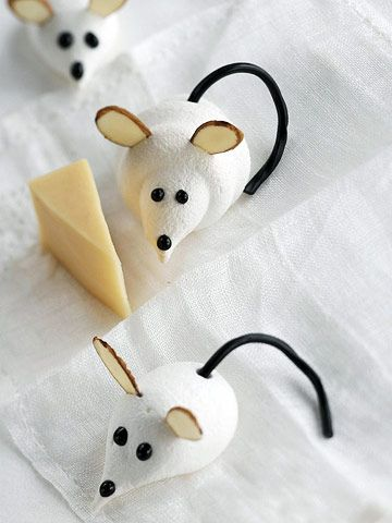 Cute L'il Meringue Mice  These fluffy mice are as simple to make as they are cute. Almond slivers make the ears, licorice forms the tail, and chocolate decorating gel is all you need to create the eyes and nose.  See Cute Cute L'il Meringue Mice recipe