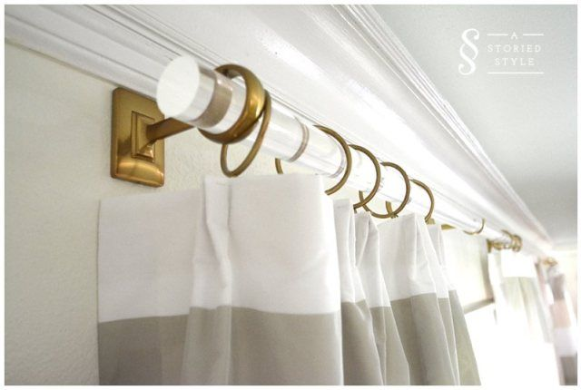 Acrylic and brass curtain rods. AStoriedStyle.com