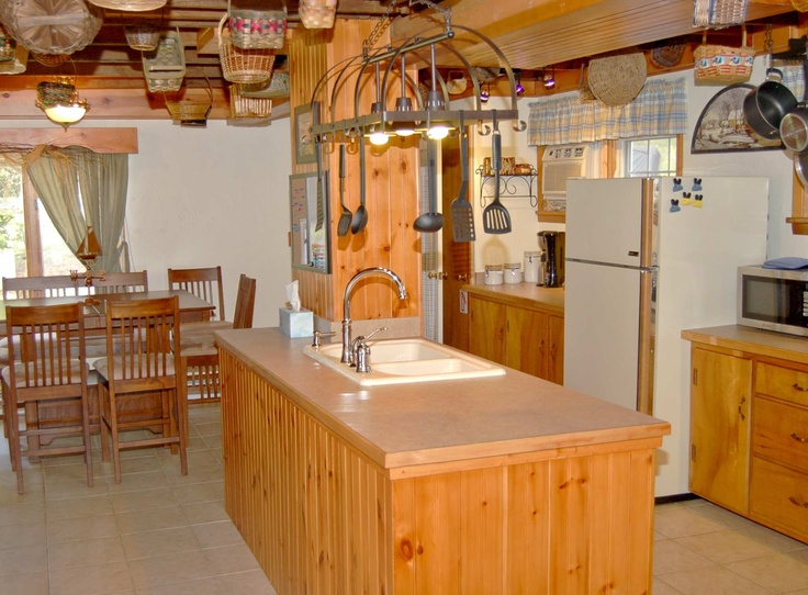 kitchen island with sink and dishwasher plenty of room to work next