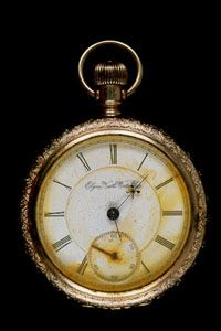 This pocket watch, found on John Starr March's body recovered at sea, stopped at 1:27.  As such, it suggests that the postal clerks survived the rush of water in the mail compartment around 11:40 p.m. It supports the eye witness accounts of survivors who saw the clerks attempting to rescue the mail until the end