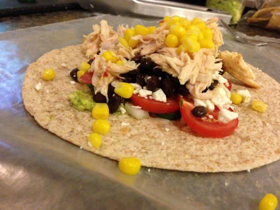 tequila chicken, guacamole and black bean burrito.