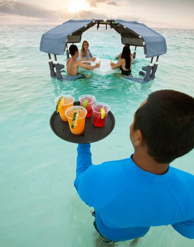 Drinks in the ocean at The Ritz-Carlton on Grand Cayman.