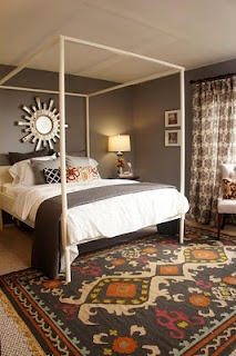 pattern drapes, dark walls, pops of pattern and color - the white really wakes this room up and keeps it from getting dreary