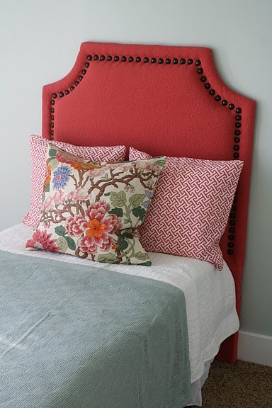 love the bright, nailhead headboard with colorful bedding - perfect for a young girl