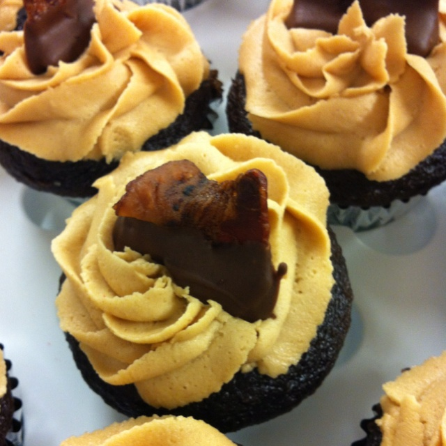 Chocolate cupcakes with peanut butter frosting topped with chocolate ...