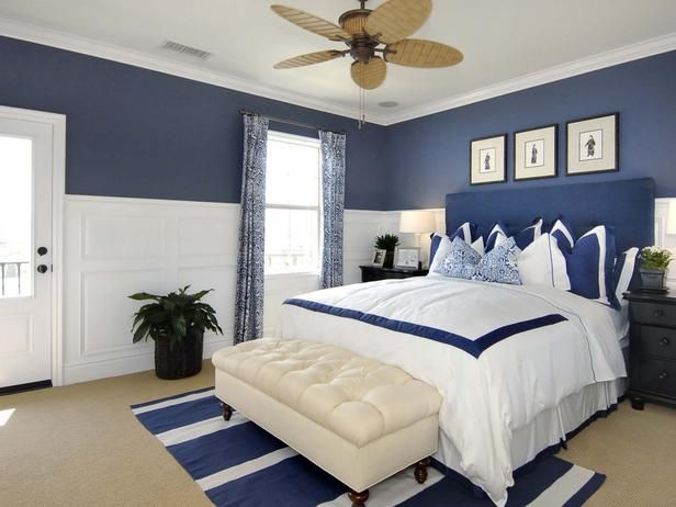 Cobalt Blue Bedroom: This master suite balances dimension and function with design elements of cobalt blue and clean white trim.  From HGTVRemodels.com