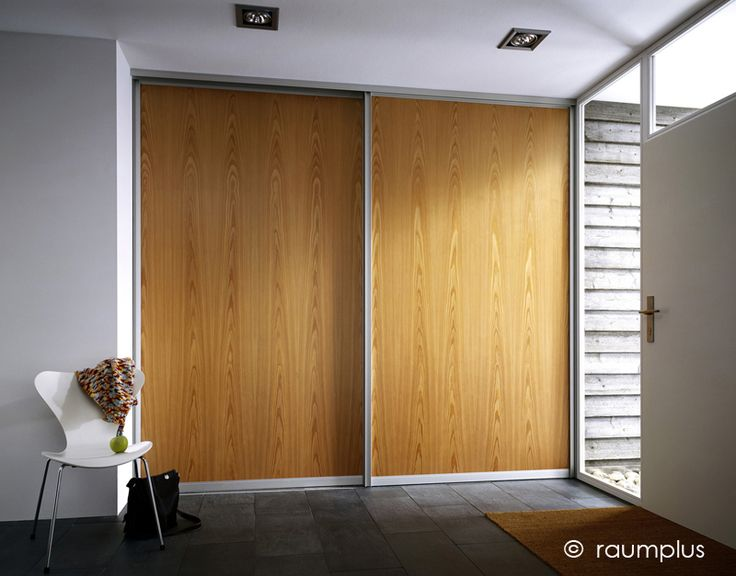 No bottom track available ceiling mounted pocket or barn door style