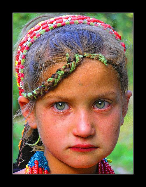 Kalash Girl - Northern Pakistan. The Kalash are fascinating. They don't share DNA markers with any other races/peoples, and they are so isolated they have managed to preserve their culture. They're the only non-muslim people in Pakistan. Even more interesting, most don't look caucasian like this girl, but it happens in their gene pool, a lot. Must learn more.