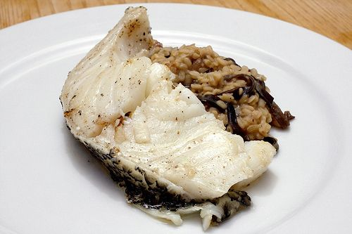olive oil poached chilean sea bass over mushroom and white lentils