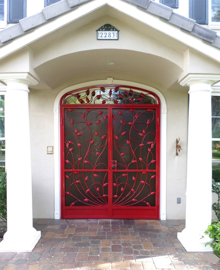 Double wrought iron vine security door wrought iron for Double security doors