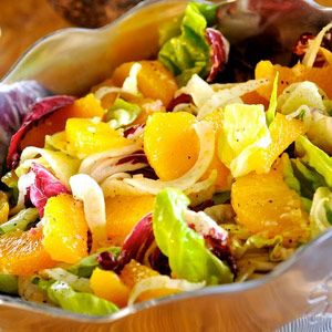 A beautiful salad of radicchio and butter lettuce in two contrasting colors of spring: green and deep purple. Topped with paper-thin fresh fennel bulb and plump orange segments, tossed with a homemade raspberry-citrus vinaigrette.