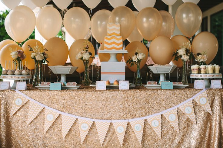 peach and gold dessert table with sequin linens and an ombre balloon backdrop #whhostess #thepartydressmagazine