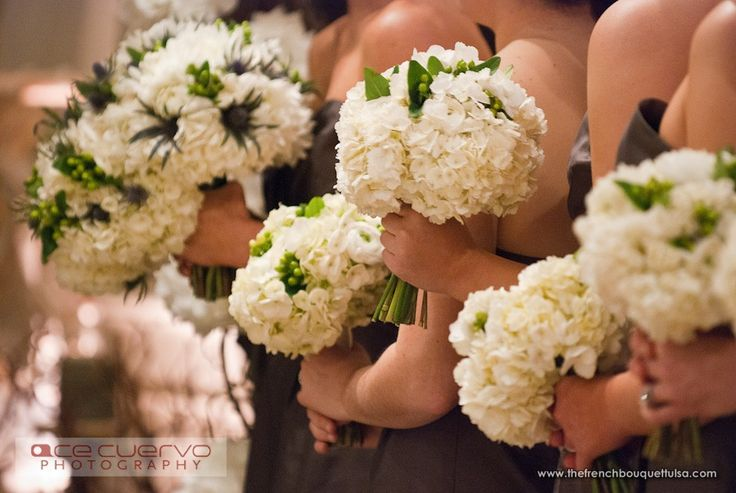 Bridesmaid Bouquets Of White Hydrangea And Ranunculi Green Hypericum