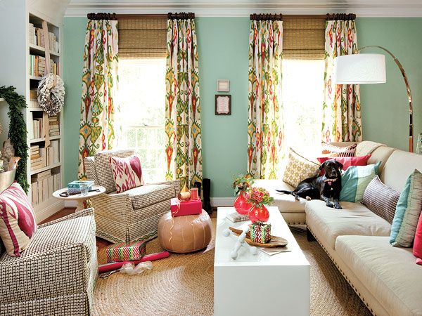 definitely one of my favorites. love the furniture layout & brights mixed with beige tones (jute rug, neutral sofa)
