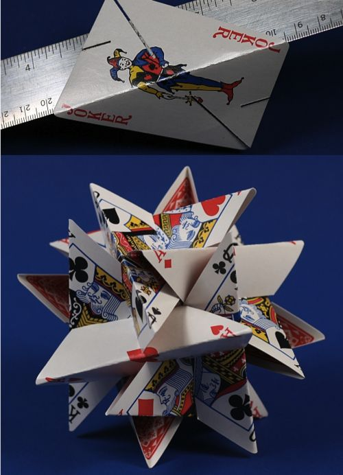 12-Card folded playing card sculpture. If you look at the part with the ruler, you can figure out how he did it.  Click through to the instructions and other cool stuff by George Hart.