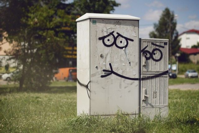 It's amazing how a few perfectly placed gestures, about 20 lines of black spray paint in this case, can completely transform two mundane boxes into something so fun. This particular piece is by Adam Łokuciejewski and Szymon Czarnowski. (via street art utopia)