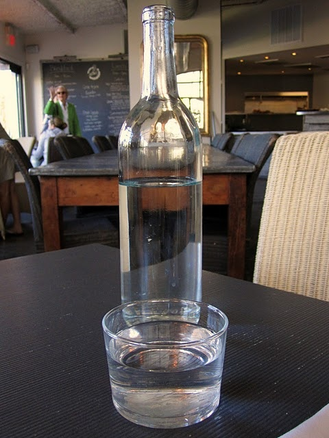 i love that this restaurant puts water in wine bottles and you take one to your table