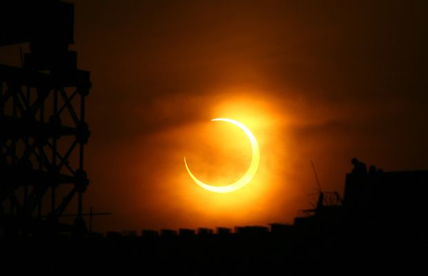 A solar eclipse appears over Zhengzhou, central China's Henan province on January 15, 2010.