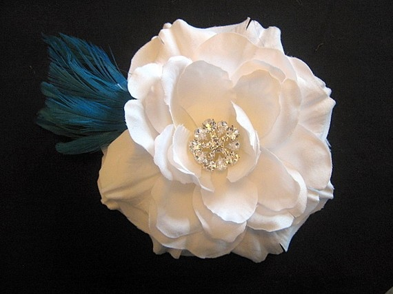 Flower with crystal center and teal blue feathers
