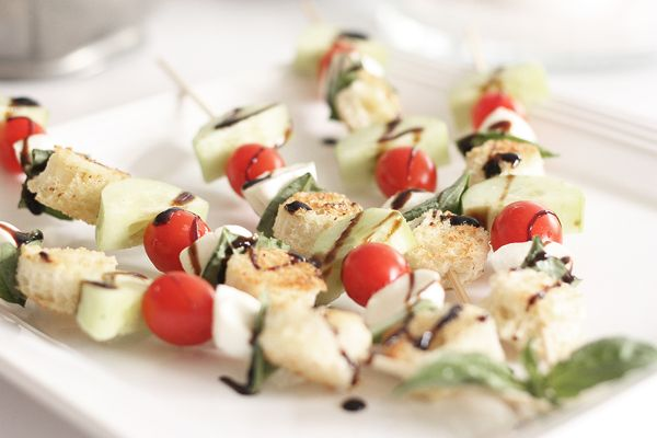 Panzanella salad skewers with tomatoes, cucumbers, bocconcini cheese ...