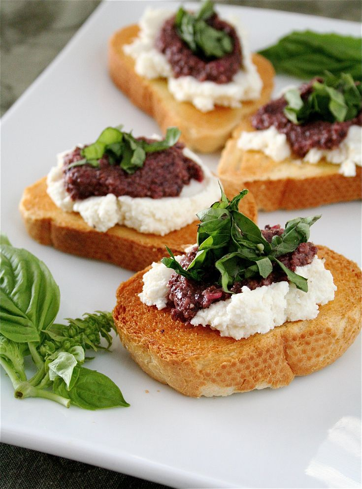 bruschetta with black olive pesto, ricotta, and basil....