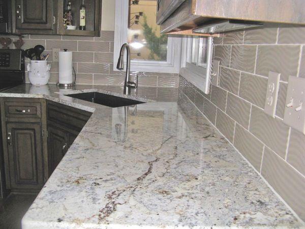 overland park contractor installs granite countertop and backsplash
