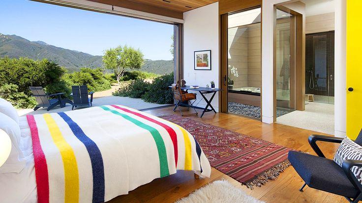 Real Estate Envy: 7 Dreamy Vacation Homes // bedroom, Pendleton blanket, kilim rug, Flokati rug, patio