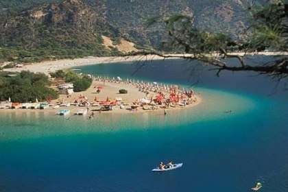 """Much of the serpentine Lycian Coast, the Turkish Riviera, is inaccessible by car, but travelers cruise its waters in traditional wooden boats.  They dock to explore sun-drenched beaches and Greco-Roman ruins or for a lunch of just-caught fish at the waterfront cafes."