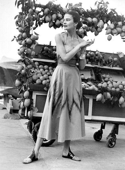 Model in a poplin halter dress, Italy, 1953