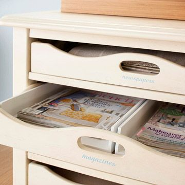 Organize your paper clutter! Clever idea for storing magazines and newspapers under the coffee table instead of on the coffee table! From #BHG