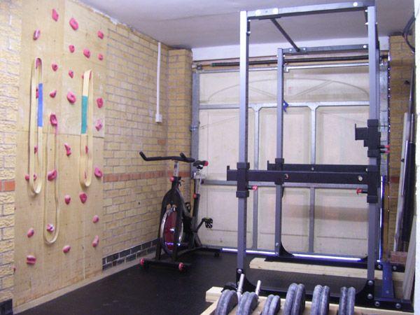A garage gym with rock climbing wall