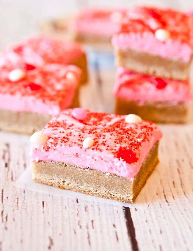 Snickerdoodle Cookie Bars with Pink Vanilla Cream Cheese Frosting. Cinnamon & sugary, chewy, & far less work than making cookies.