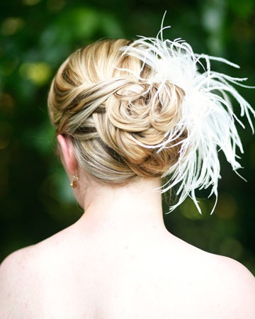 This bride accented her updo with a feathered headpiece placed perfectly to the side