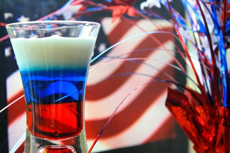 ... ever so slowly pour the cream into the shot above the blue curaçao