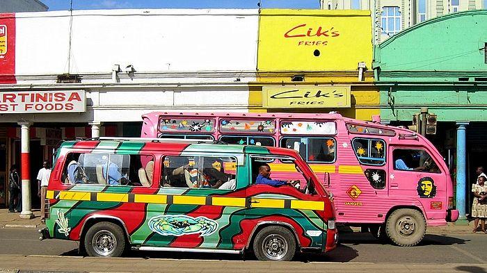 matatus in Kenya! Matatus carry three times the normal capacity of public vehicles!