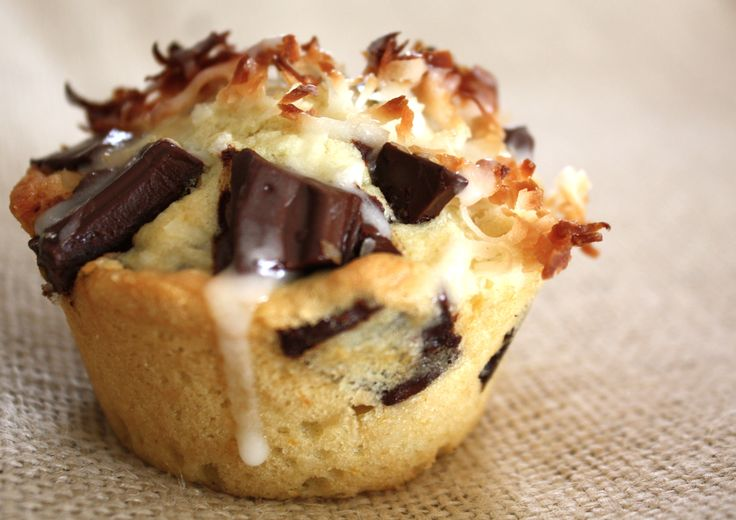 Coconut cupcakes with chocolate chunks and coconut drizzle