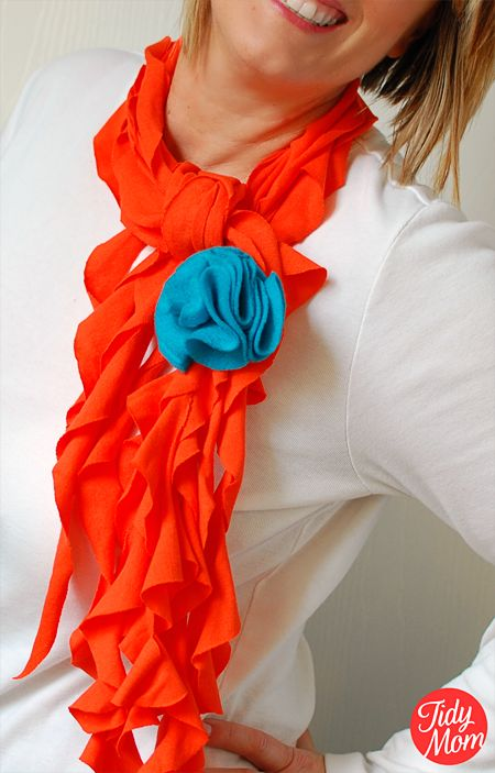 "T shirt scarf.......love it.  I made one this morning!  Still have to make the flower pin.  It was super easy, and turned out really cute.  It took me about 2 1/2 hours, but that is with having to look after a 3 year old and him wanting to ""help""!"