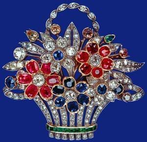 The Flower Basket Brooch which is said to be Queen Elizabeth's favorite piece of jewelry. Comprised of ruby, diamond and sapphire flowers, the brooch was given to Princess Elizabeth by her parents to mark the birth of her first child, Prince Charles, in 1948. There are numerous photos taken from 1948 to the present day which show the Queen wearing this.