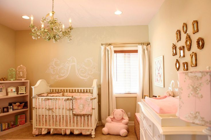 Brass frames on gallery wall adds a vintage-inspired look in this romantic baby girl nursery - #projectnursery
