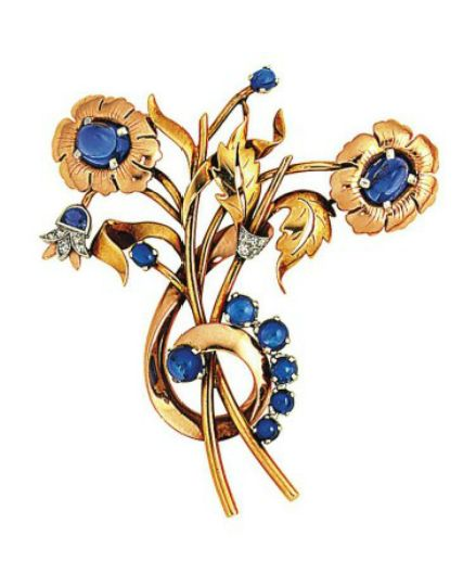 A sapphire and diamond brooch Of floral spray design, each flower set with an oval cabochon sapphire centre, with circular cabochon sapphire accents and single-cut diamond details, 6.0cm long