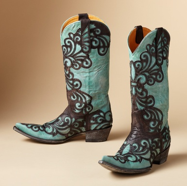 """LINDA BOOTS BY OLD GRINGO--Handmade by Old Gringo, statement-making boots in soft turquoise leather appliquéd with fleur de lis and flourishes of chocolate leather. Leather lining and sole. Imported. Whole and half sizes 6 to 10, 11. 1-3/4"""" canted heel. These boots are running 1/2 size large.View our entire Old Gringo Collection."""