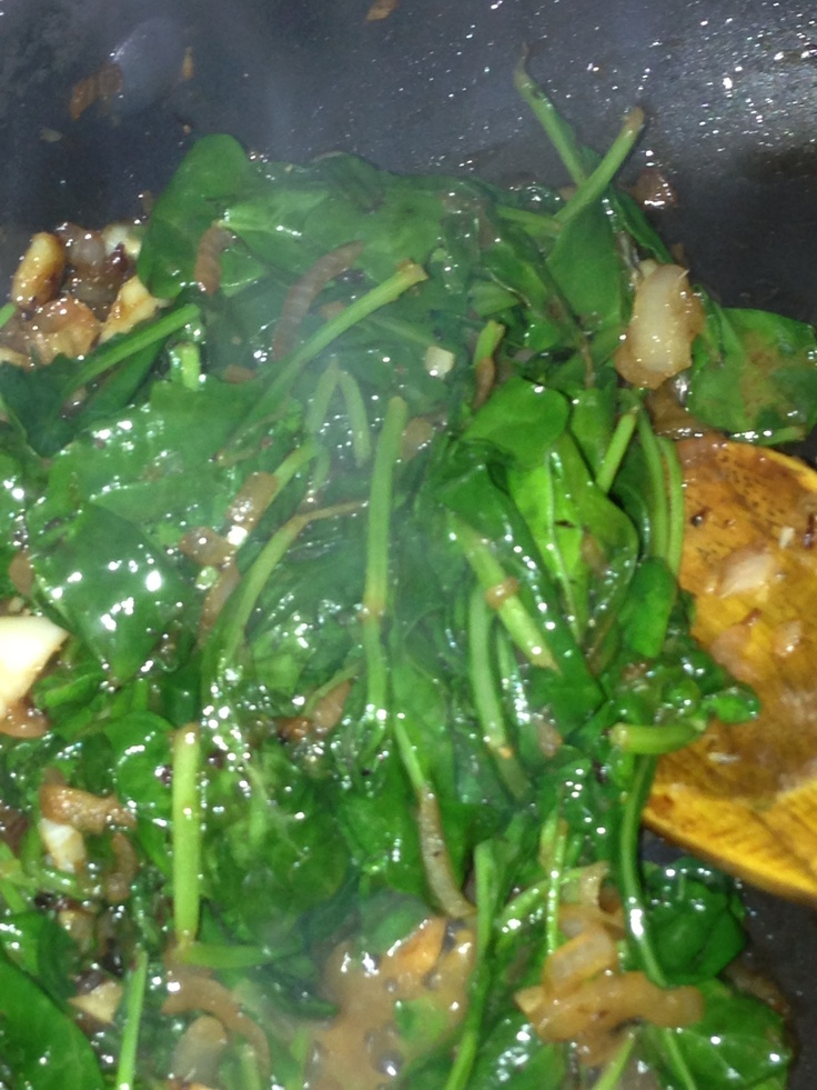 Baby kale and spinach steamed and tossed with sautéed sliced garlic ...