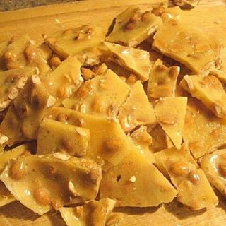 Easy Peanut Brittle: Mix 1/2 cup light corn syrup & 1 cup of sugar in ...