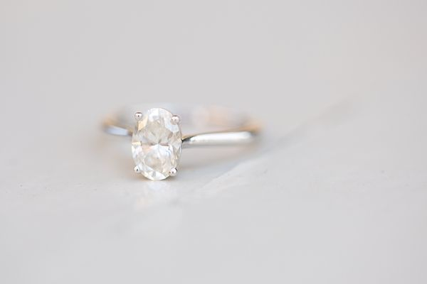 simple oval engagement ring tying the knot
