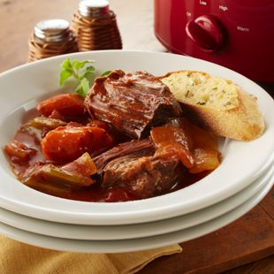 Ridiculously easy Crockpot Italian Beef Roast.   Just diced veggies, canned Italian tomatoes, tomato paste with Italian spices, and then the roast.   VOILA!