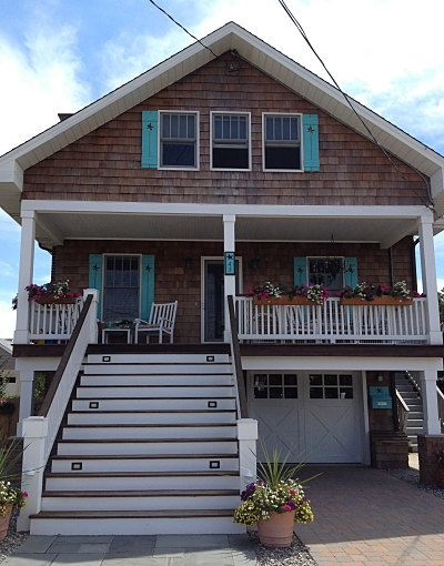 Shutter exterior interior one wood wooden beach cottage for Beachy exterior shutters
