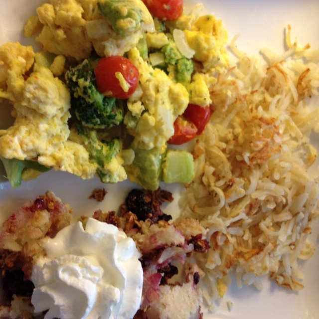 Scrambled eggs with broccoli, cherry tomatoes, light cheddar and ...