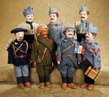 Very Rare Set of French WWI Soldiers in Original Uniforms with Original Artist Labels 2000/2500   Proxibid Auctions   I Love these!   sold for 1600.00   12''(30cm.)designed by French artist Albert Guillaume, circa 1916 and produced by the doll firm of Emile Lang, depicting French colonial and Allied forces in WWI. With original costumes and labels, they are near-perfectly preserved.  and really neato!